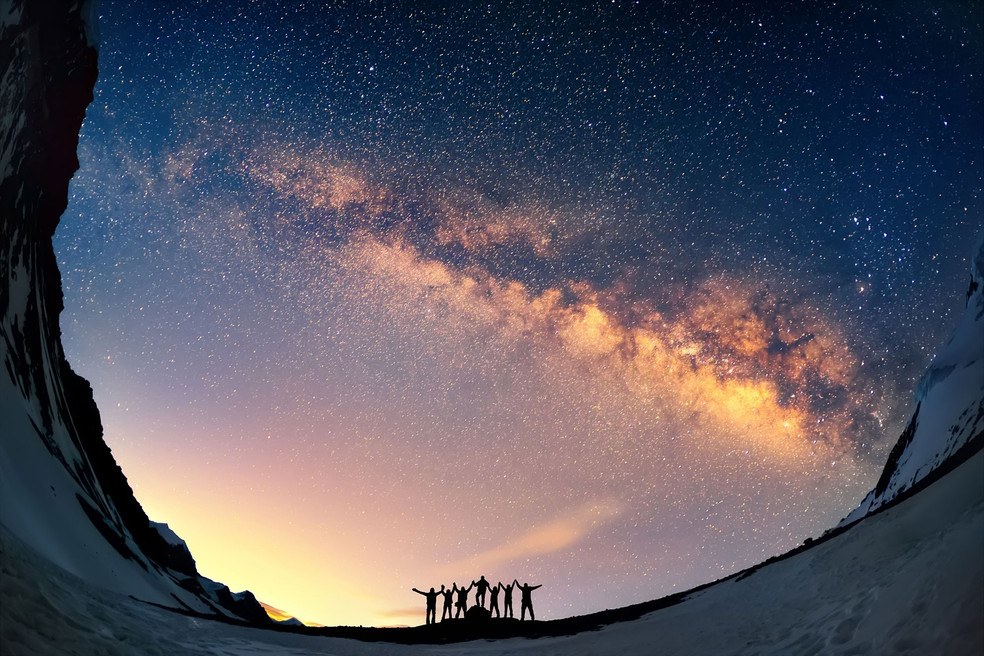 People standing under a starry sky