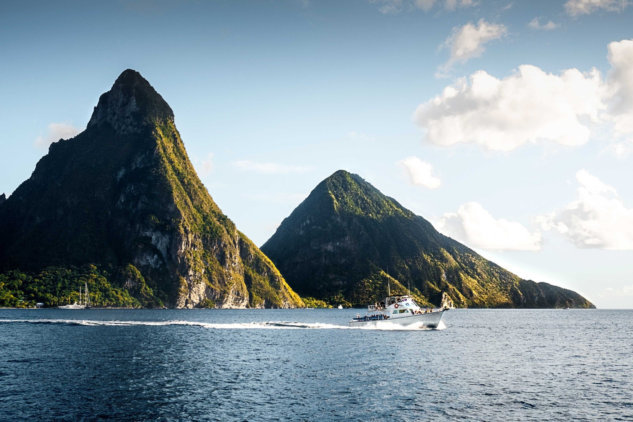 The Piton peaks with a boat in the water